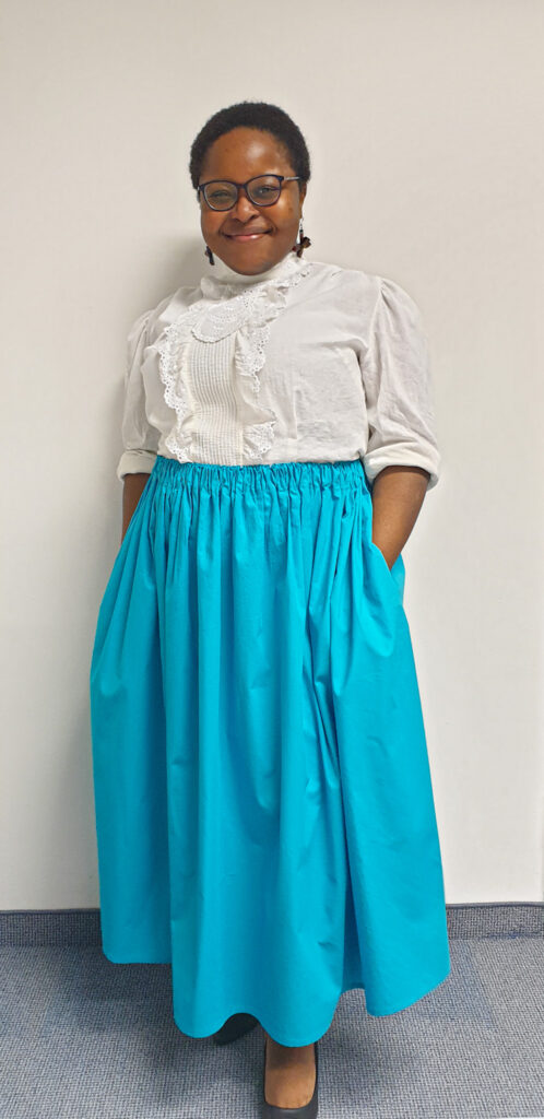 A picture of me wearing the finished gathered skirt.