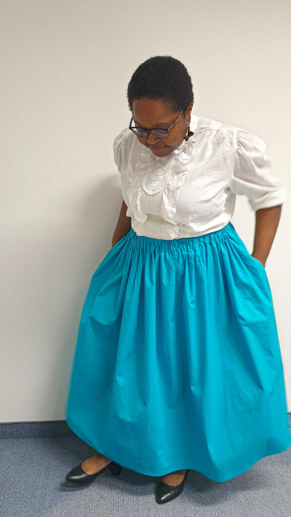Another picture of me wearing the finished gathered skirt.