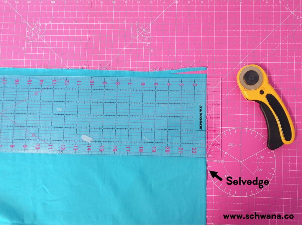 How to place your ruler in relation to the selvedge.