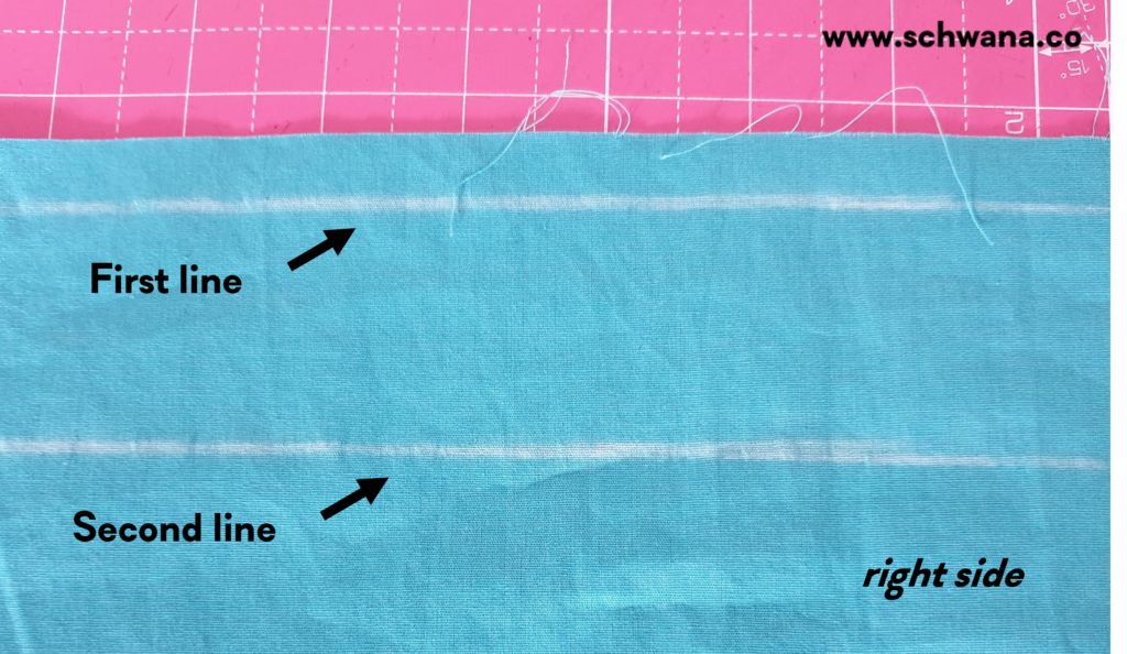 The two chalk lines at the top of the skirt pieces.