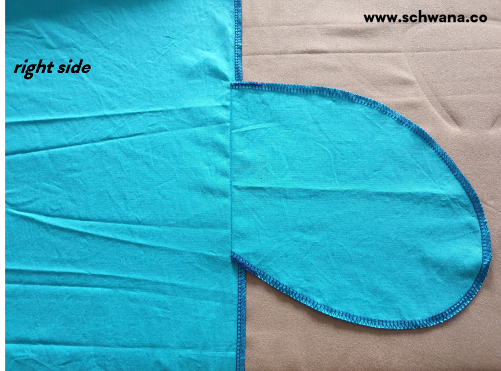 Pressing the sewn-on pocket piece to the side.