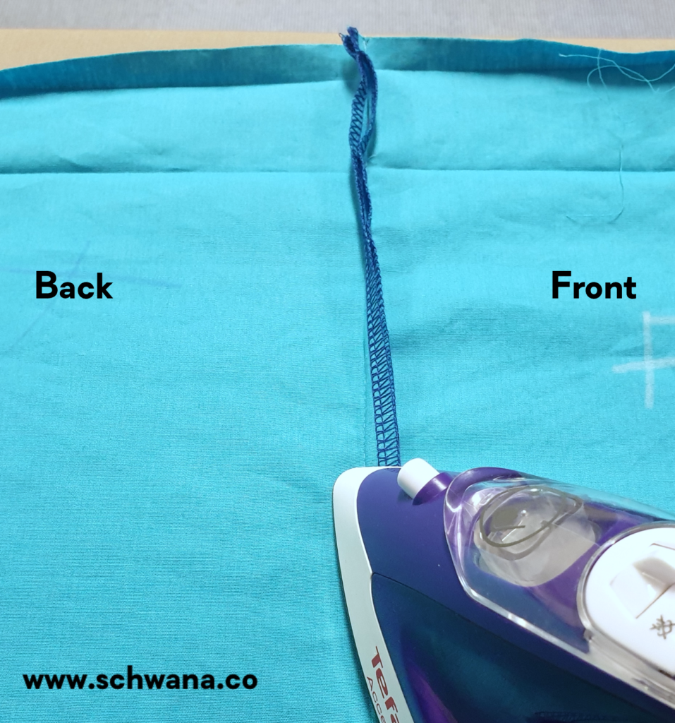 How to press the side seam towards the front skirt piece.