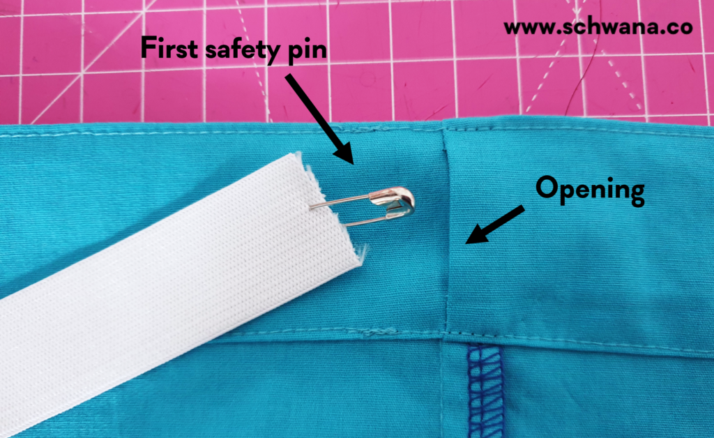 How to attach the first safety pin.